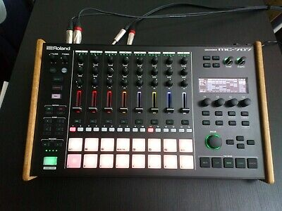 Roland MC-707 Groovebox with solid oak cheeks. Excellent condition