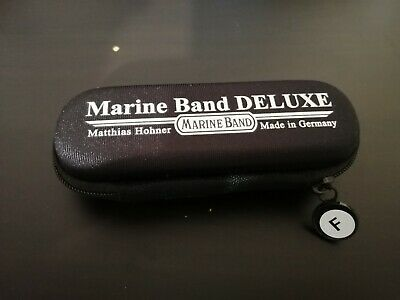 Marine Band Deluxe case, key of F sticker, and a free month of lessons