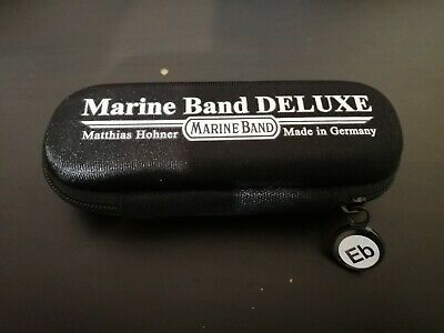 Marine Band Deluxe case, key of Eb sticker, and a free month of lessons