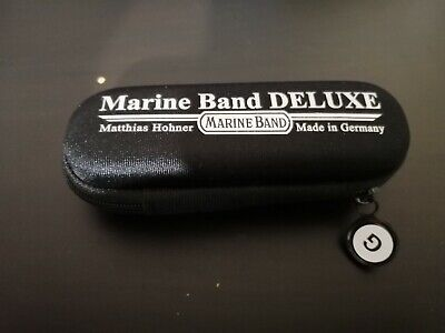 Marine Band Deluxe case, key of G sticker, and a free month of lessons